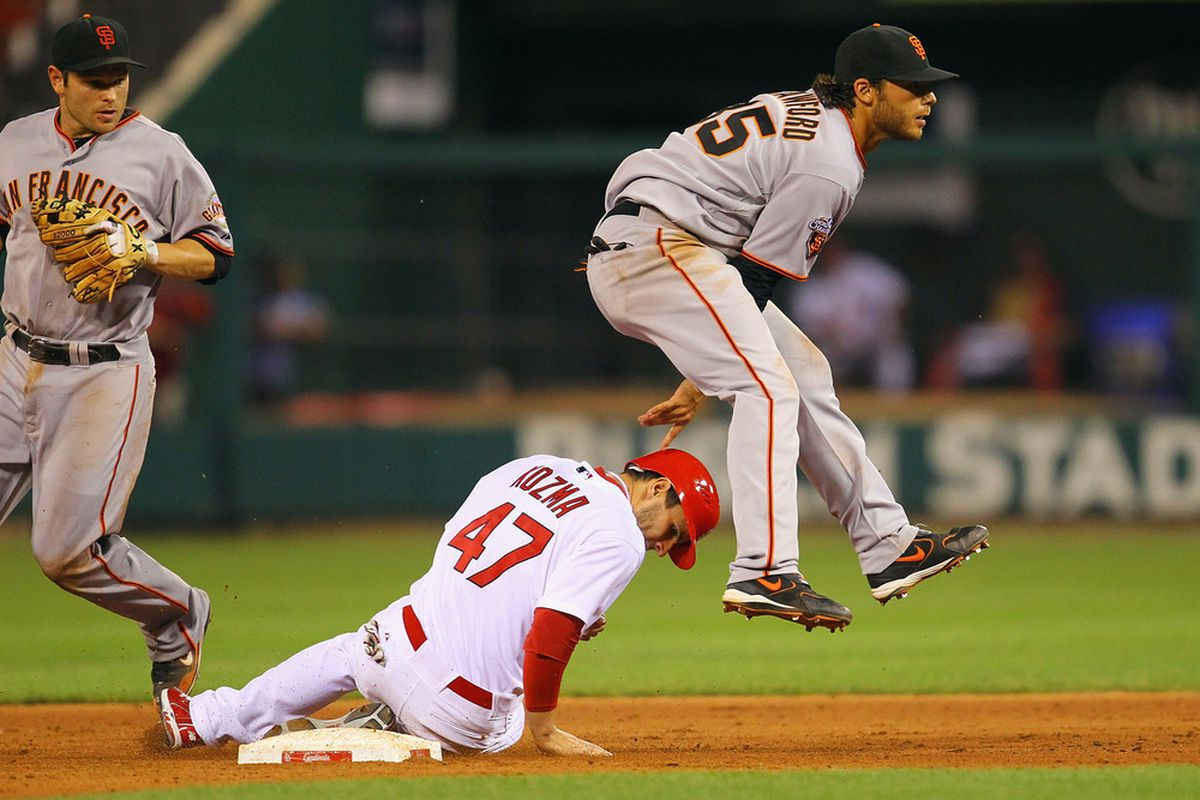 ST. LOUIS, MO - JUNE 1: Brandon Crawford #35 of the San Francisco Giants turns a double play over Pete Kozma #47 of the St. Louis Cardinals at Busch Stadium on June 1, 2011 in St. Louis, Missouri.  (Photo by Dilip Vishwanat/Getty Images)