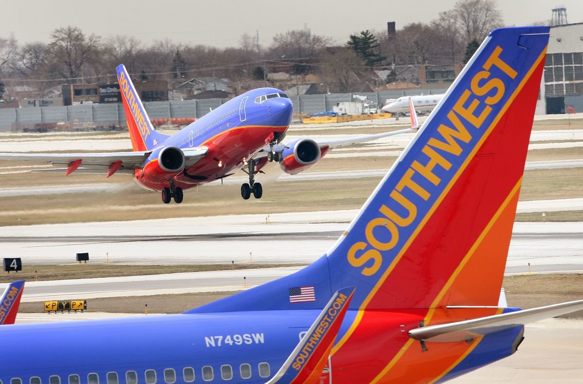 A Southwest Airlines jet takes off at Midway Airport.