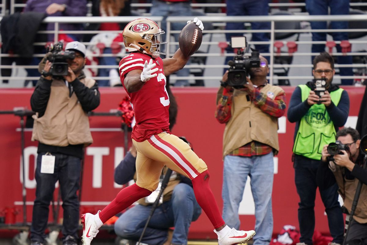 San Francisco 49ers running back Raheem Mostert celebrates after scoring a touchdown against the Green Bay Packers in the first half of the NFC Championship Game at Levi's Stadium.