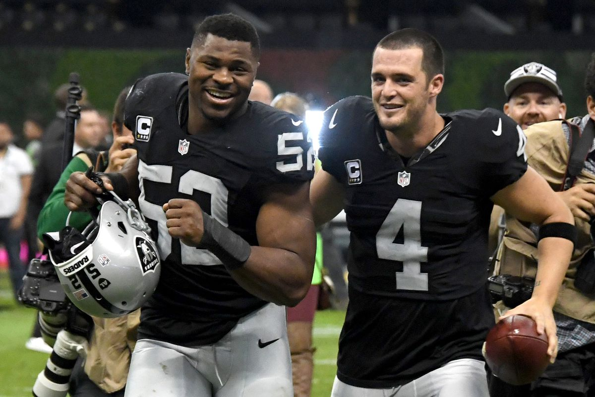 Derek Carr says he placed his hand on Khalil Mack during the