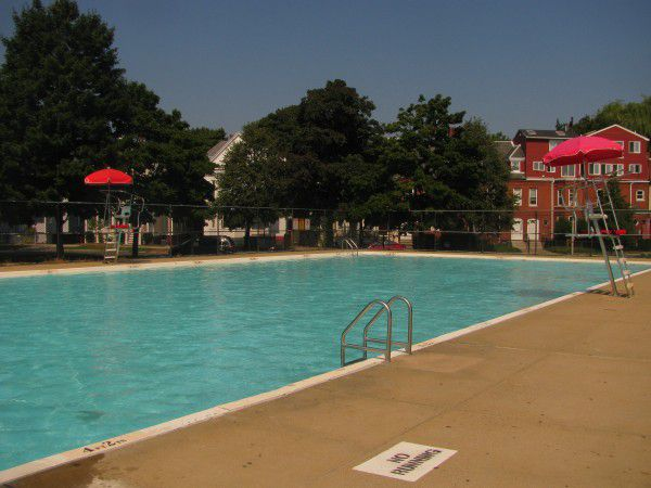 A large in-ground outdoor pool.