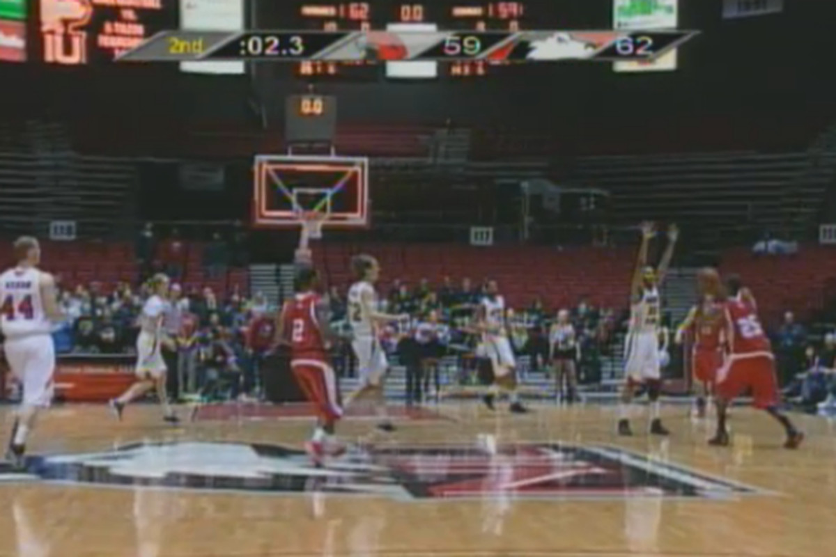 Jon Harris' shot was almost from halfcourt, and it almost counted.