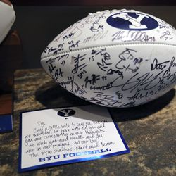 A signed football and letter from BYU football coaches, staff and team members are pictured in Sy Kimball's home in Provo on Monday, Oct. 11, 2021. Kimball is one of the largest donors to BYU sports. Thefootball and letter are just some of the many pieces of BYU sports memorabilia Kimball has collected.