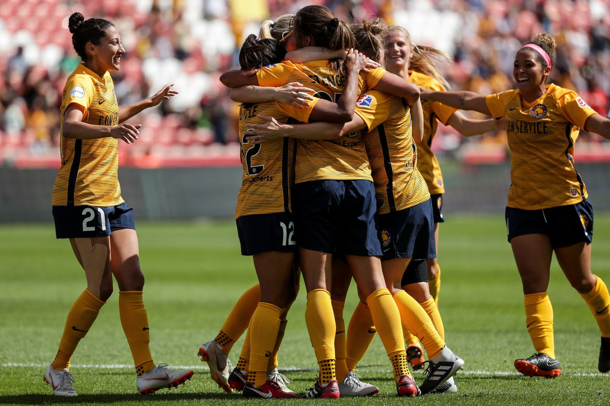 Utah Royals FC players celebrate after forward Katie Stengel (24) scored on the Chicago Red Stars, putting the Royals up 2-1, in a match at Rio Tinto Stadium in Sandy on Saturday, Sept. 8, 2018.