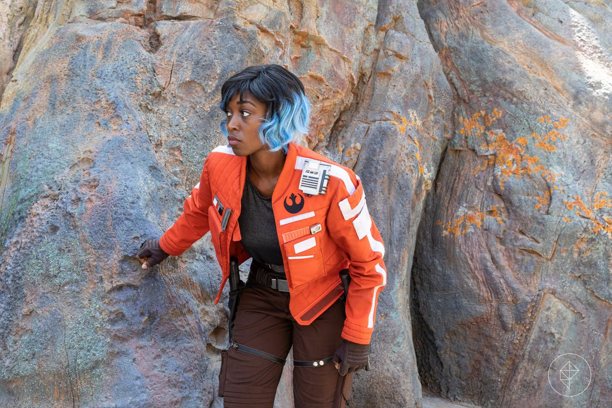 Vi Moradi hides among the rocks inside Galaxy's Edge on opening day.