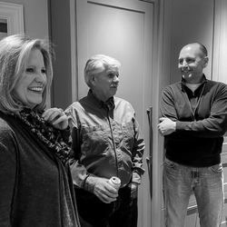 Henry and Stacey Specht catch up with contractor Tommy Silva in the kitchen as the party continues.