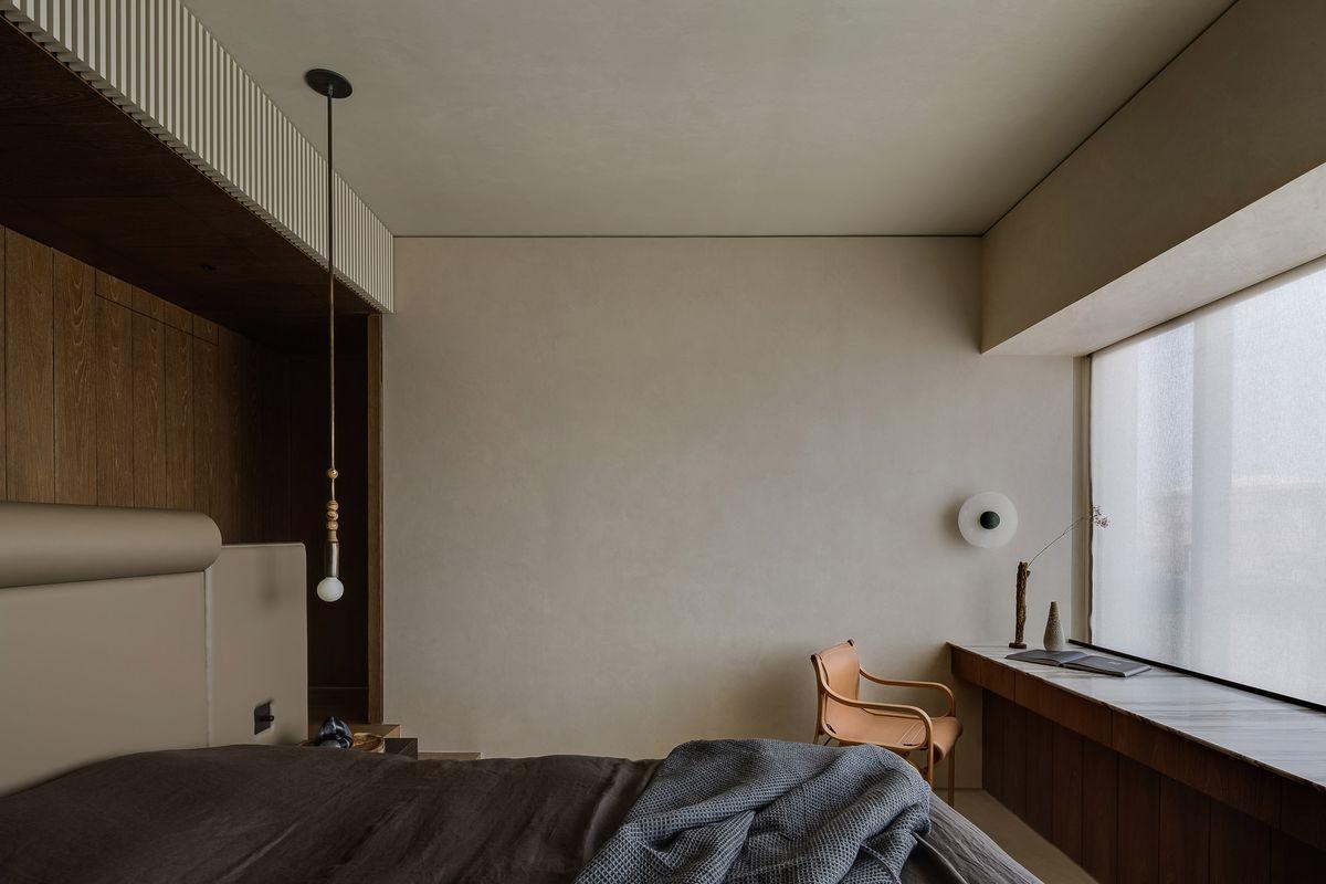 Bedroom with minimalist furniture.