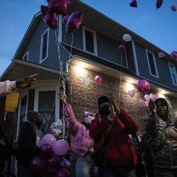 Dozens of family members and supporters of 7-year-old Jaslyn Adams release balloons during a vigil outside the girl's grandmother's West Side home, Wednesday evening, April 21, 2021. Jaslyn was fatally shot Sunday, April 18, while in line at a McDonald's drive-thru with her father, who suffered one gunshot wound to the back and survived.