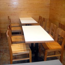 The tables and chairs in the back seating area.