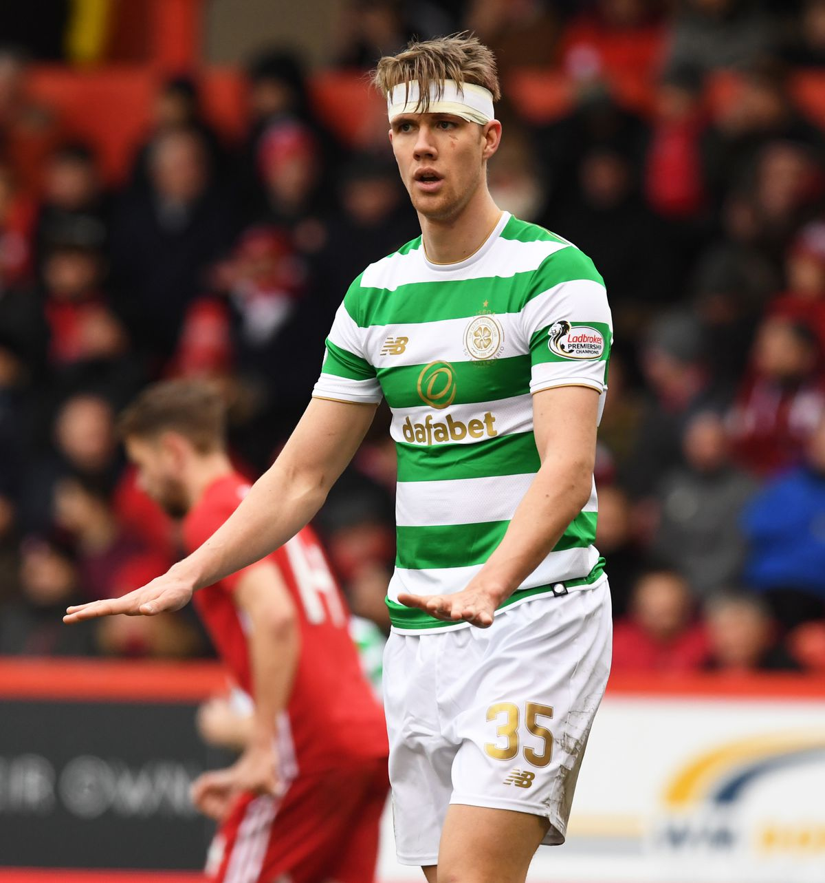 25/02/18 LADBROKES PREMIERSHIP.ABERDEEN V CELTIC.PITTODRIE - ABERDEEN.Celtic's Kristoff Ajer after being treated for a head knock.