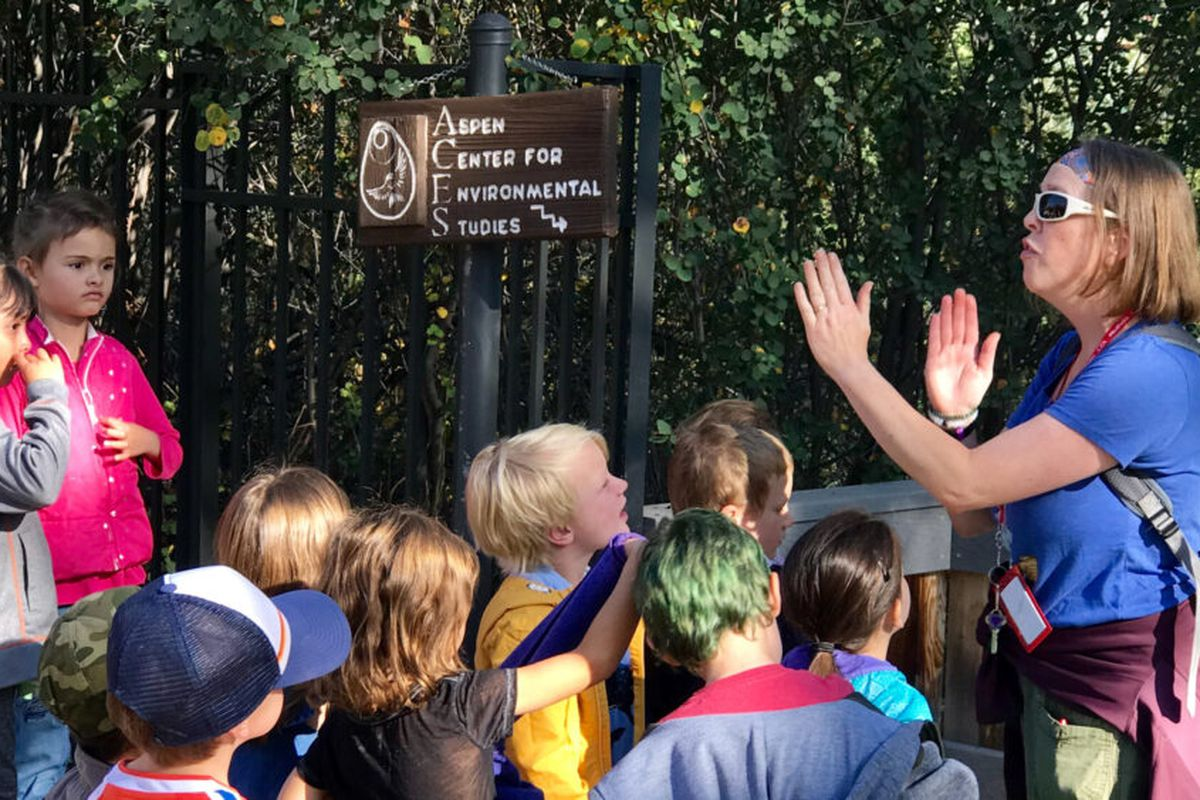 Teacher Kay Erickson leads students on a hike well before coronavirus closed schools in Aspen, Colorado.