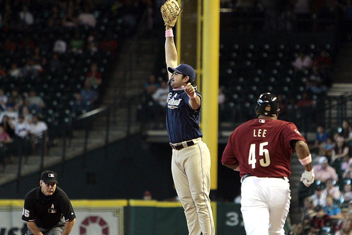 Adrian can't reach Hairston Jr's throw because it's 15 feet in the air.