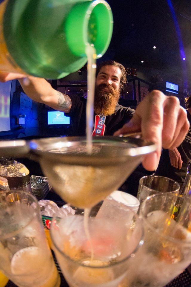 Jon Olson pouring for La Belle Vie. Photo by Brian Stanley for Iron Bartender