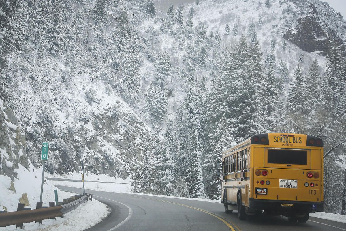 FILE - A school bus from Butler Elementary School drops children off along Big Cottonwood Canyon in Cottonwood Heights on Tuesday, April 25, 2017. The Canyons Board of Education voted late Tuesday to direct school administrators to explore entering a cont