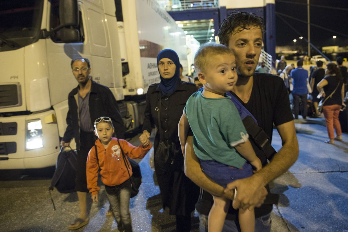 Migrants disembark from a bus near Athens, Greece (Dan Kitwood/Getty)
