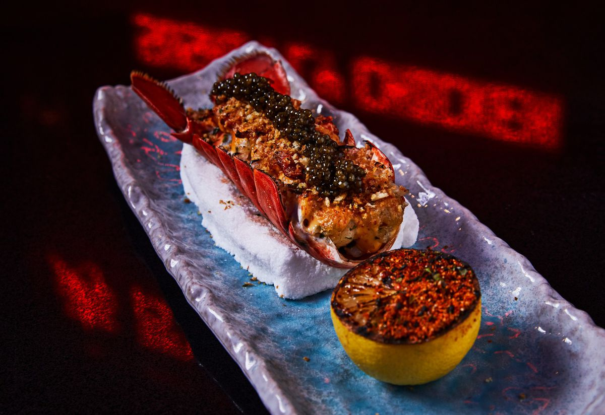 lobster on a long silver plate topped with caviar