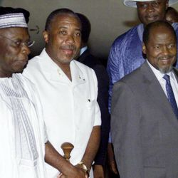 FILE - This Monday, Aug. 11, 2003 file photo shows former Liberian president Charles Taylor, center, flanked by Nigerian President Olusegun Obasanjo, left, and President Joachim Chissano of Mozambique, right, as Taylor arrived into exile at Abuja international airport, Nigeria.