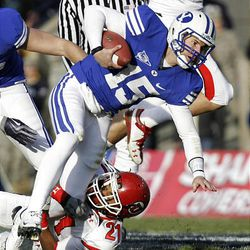 BYU quarterback Max Hall scrambles away from Utah defensive back Lamar Chapman as BYU and Utah play at LaVell Edwards Stadium Saturday in Provo. BYU won in overtime, 26-23.