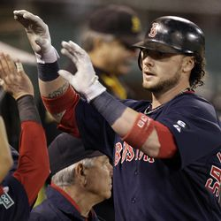Boston Red Sox's Jarrod Saltalamacchia  is congratulated after hitting a home run off Oakland Athletics' Brandon McCarthy  in the fourth inning of a baseball game Friday, Aug. 31, 2012, in Oakland, Calif.