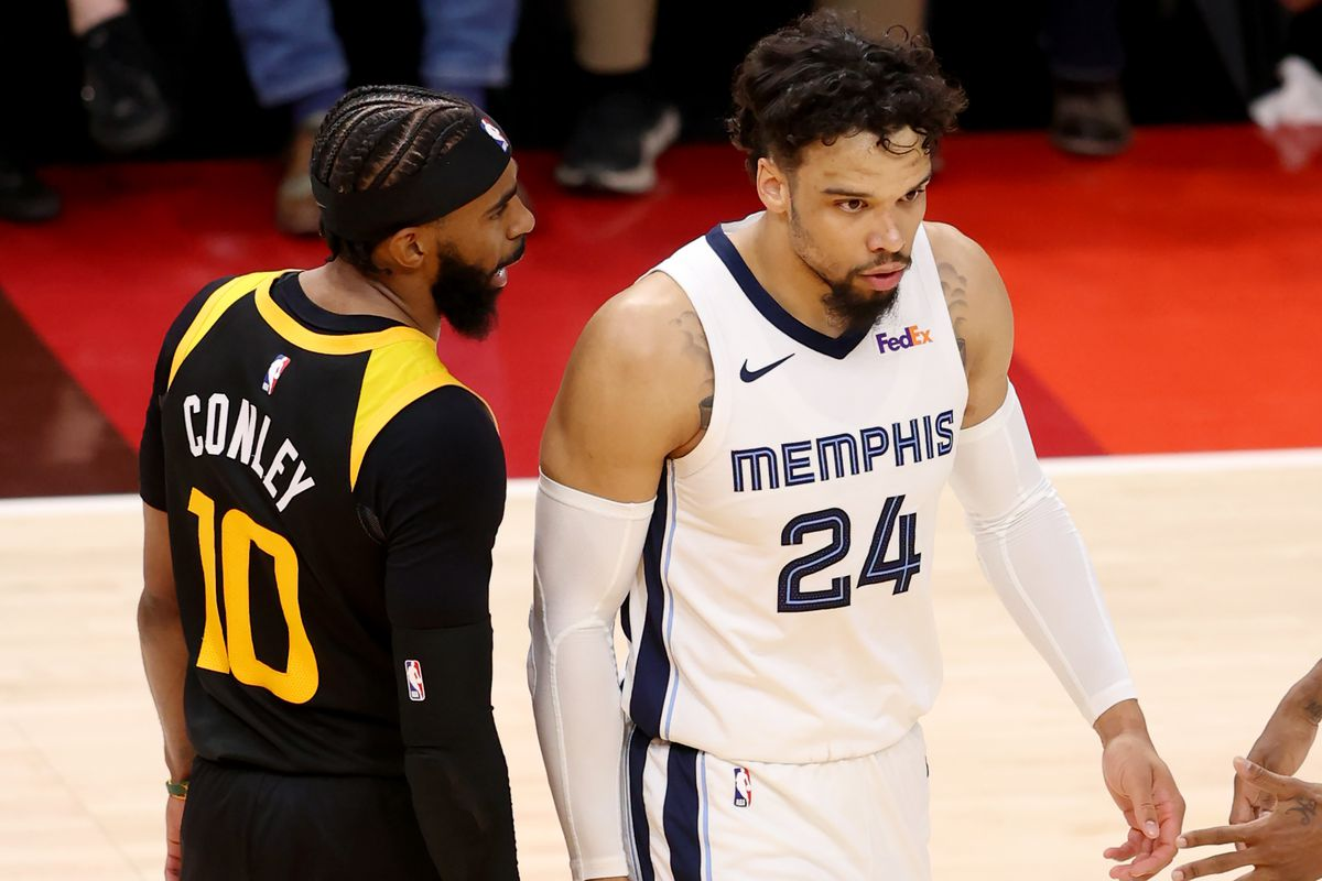 Jazz guard Mike Conley has a few words for Memphis Grizzlies' Dillon Brooks during a playoff game in Salt Lake City, Utah.