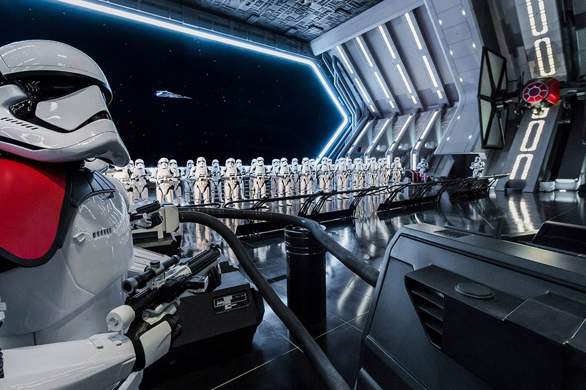 an interior shot of Rise of the Resistance, which features an army of stormtroopers in a vast spaceship-like space