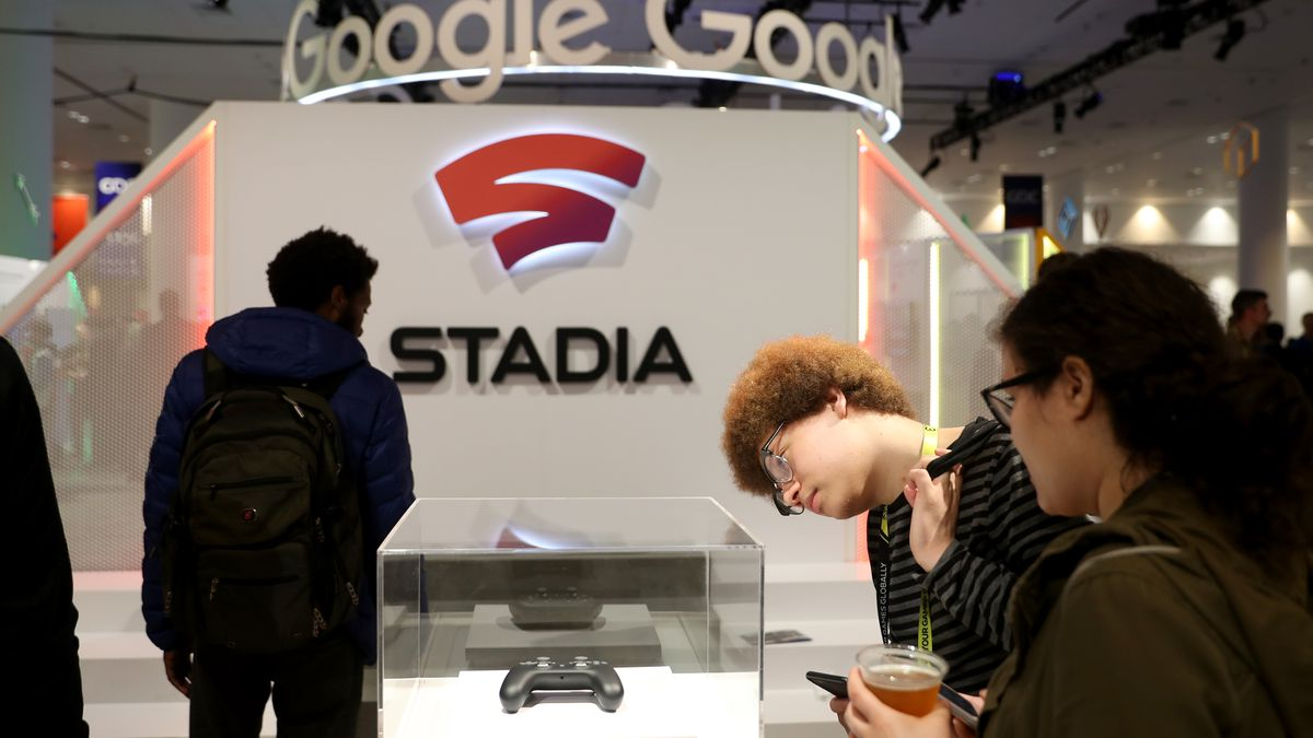 Attendees look at the new Stadia controller on display at the Google booth at the 2019 GDC Game Developers Conference on March 20, 2019 in San Francisco, California