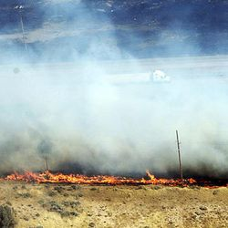 A wildfire burns along I-84 near the mouth of Weber Canyon on Tuesday, Sept. 5, 2017.