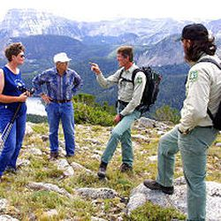 ATV enthusiasts Judy and John Hochmuht of Livingston, Mont., talk with Forest Service officials Jonathan Klein and David DeSimone.