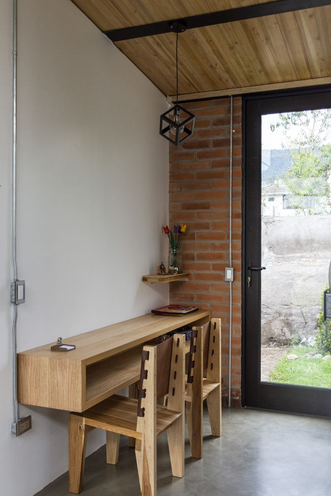 Wooden desk attached to wall.