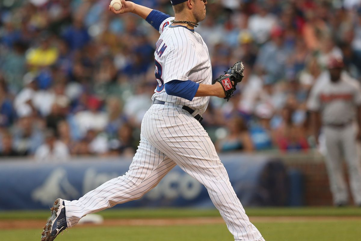 Starting pitcher Paul Maholm of the Chicago Cubs delivers the ball against the Arizona Diamondbacks at Wrigley Field in Chicago, Illinois. (Photo by Jonathan Daniel/Getty Images)