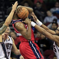 New Jersey Nets' Shelden Williams, right, Deron Williams, left, and Kris Humphries, second from left, block a shot by Washington Wizards' Kevin Seraphin, of France, during the first half of an NBA basketball game in Newark, N.J., Friday, April 6, 2012. The Nets won 110-98.