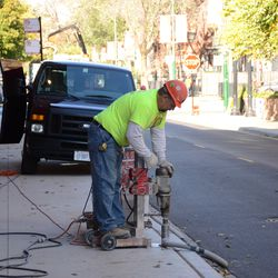 1:02 p.m. Holes being drilled along the Sheffield Avenue curb -