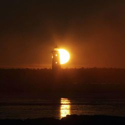 The sun sets behind the Manistique, Mich., Lighthouse on Feb. 10, 2011.