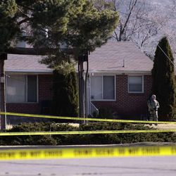 Law enforcement officers and crime scene investigators continue to work at the scene of an overnight shooting at a home in Ogden Thursday, January 5, 2012. Six officers, some from the Weber Morgan Narcotics Strike Force were shot last while serving a warrant at 3268 Jackson Ave.