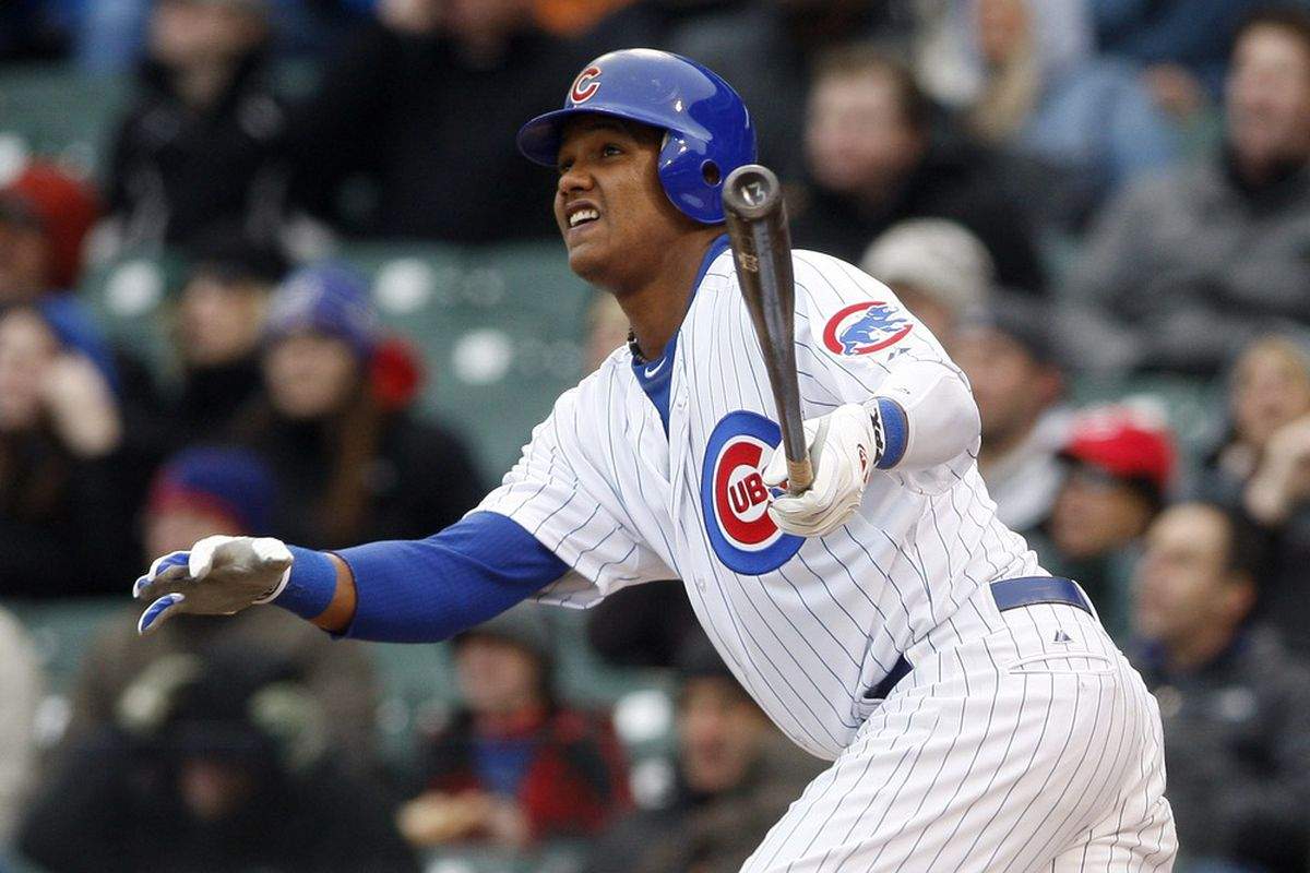 Chicago, IL, USA; Chicago Cubs shortstop Starlin Castro hits a RBI double during the third inning against the Cincinnati Reds at Wrigley Field.  Credit: Jerry Lai-US PRESSWIRE