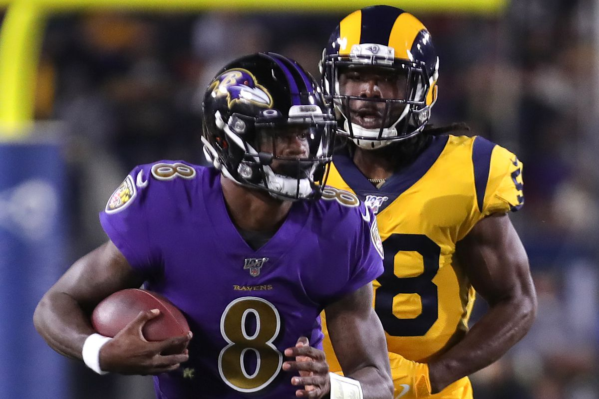 Quarterback Lamar Jackson of the Baltimore Ravens carries the ball against the Los Angeles Rams at Los Angeles Memorial Coliseum on November 25, 2019 in Los Angeles, California.