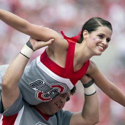 Members of the Ohio State Buckeyes cheerleading squad entertain the crowd after a touchdown against the Buffalo Bulls at Ohio Stadium. Ohio State won the game 40-20.