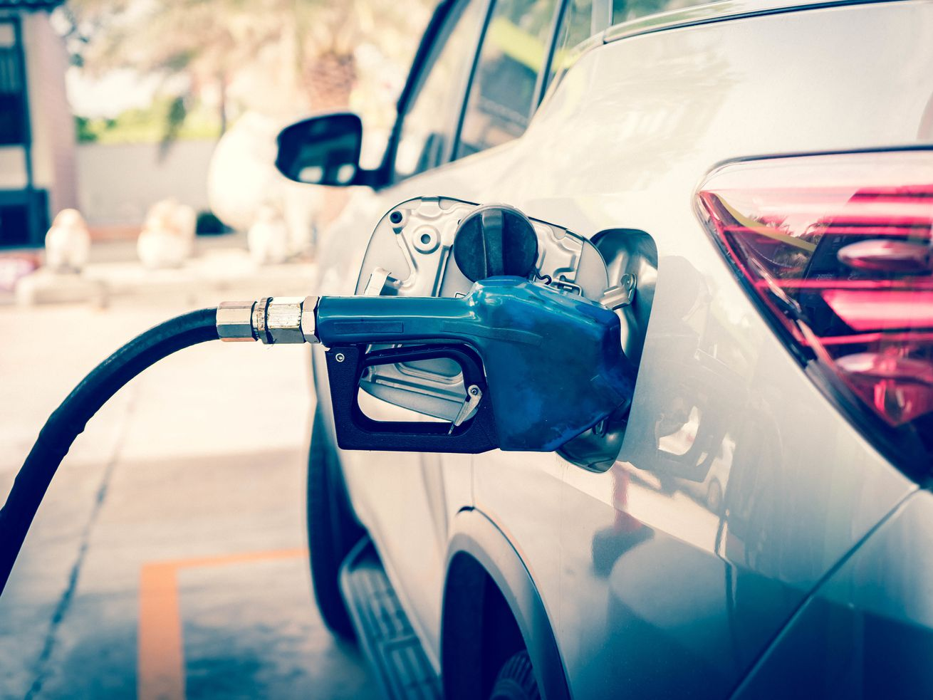 filling up car with gas