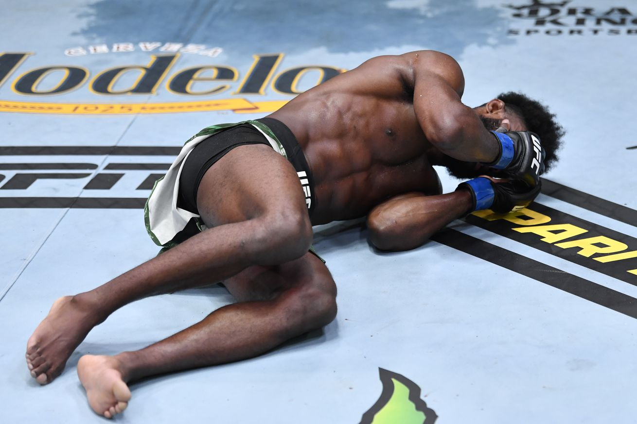 DQ!! Watch Aljamain Sterling win title after illegal knee