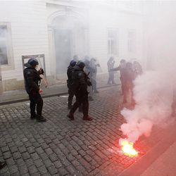 Croatian anti-riot police guard the road leading to the parliament and government buildings, during a protest in Zagreb, Croatia, Saturday, Feb. 26, 2011. Some 15,000 anti-government protesters rallied in the Croatian capital and some clashed with police.