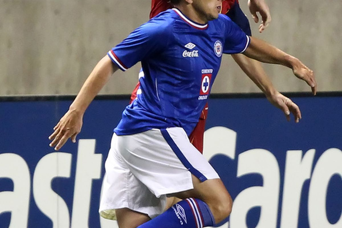 Will Johnson #8 of Real Salt Lake and Javier Aquino #7 of Cruz Azul fight for the ball during a CONCACAF Champions League game. Aquino will become a key player for La Maquina in the 2012 Clausura.