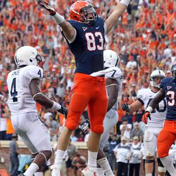 Virginia tight end Jake McGee (83) celebrates a fourth-quarter touchdown during an NCAA college football game against Penn State on Saturday Sept. 8, 2012, in Charlottesville, VA. Virginia defeated Penn State 17-16.