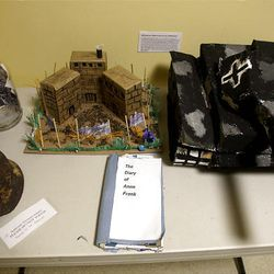 The Beehive Academy prepared this display about World War II. Its former principal has blamed Jews for the Holocaust.