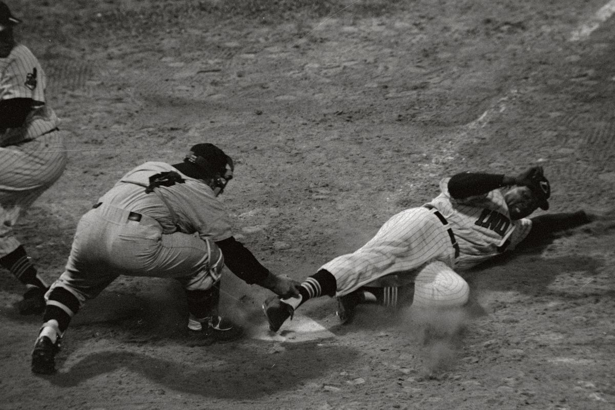 Vic Power Sliding Into Home Plate