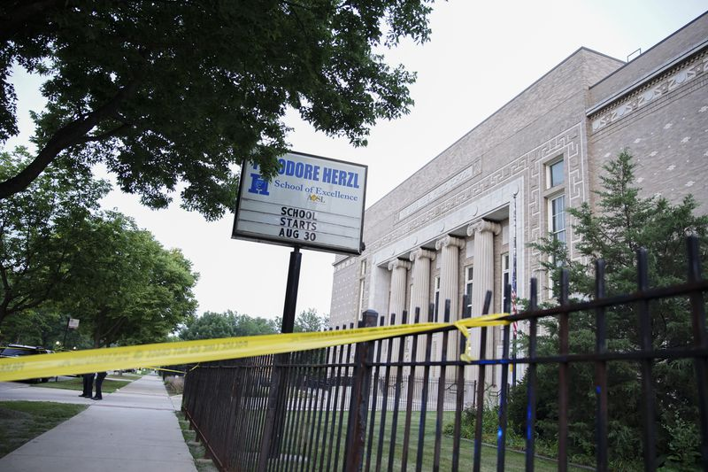 Police tape blocks off a section of the crime scene in front of Theodore Herzl School at the corner of W Douglas Blvd and S Ridgeway Ave in Lawndale, Wednesday, July 21, 2021.   Anthony Vazquez/Sun-Times