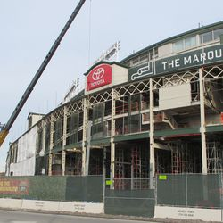 Wed 1/6: main entrance area, new sheathing on the main gate verticals. Crane delivering a new sheath -