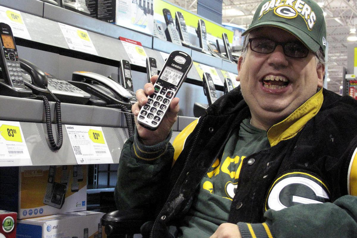 Sean Irvin browses phones at a Best Buy store Monday, Sept. 17, 2012, in Anchorage, Alaska. It's one of the ways Irvin plans to spend his yearly Alaska Permanent Fund dividend, whose amount was being announced Tuesday.