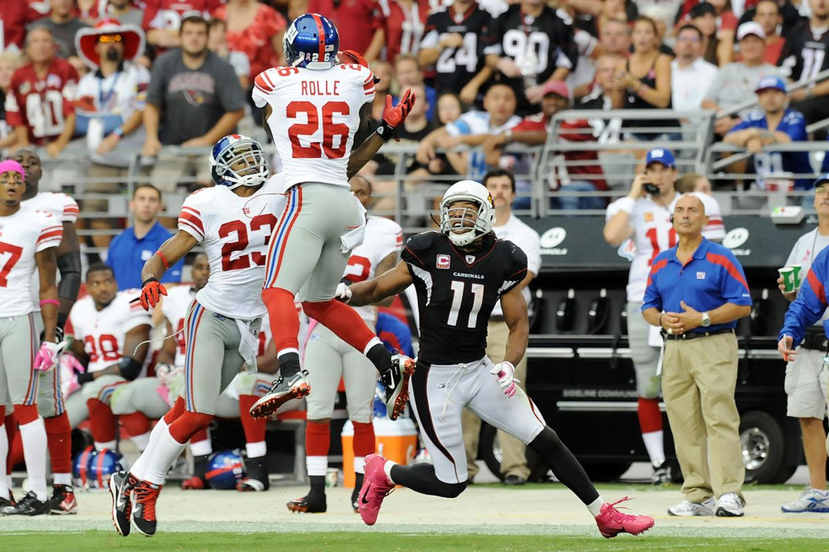 Antrel Rolle (26) of the New York Giants intercepts a pass intended for Larry Fitzgerald (11) of the Arizona Cardinals at University of Phoenix Stadium on October 2, 2011 in Glendale, Arizona. Giants won 31-27.  (Photo by Norm Hall/Getty Images)
