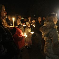 Powell family friends and well wishers hold a candlelight vigil in Salt Lake County  Sunday, Feb. 5, 2012. Josh Powell and his two sons were killed in an explosion in Washington.