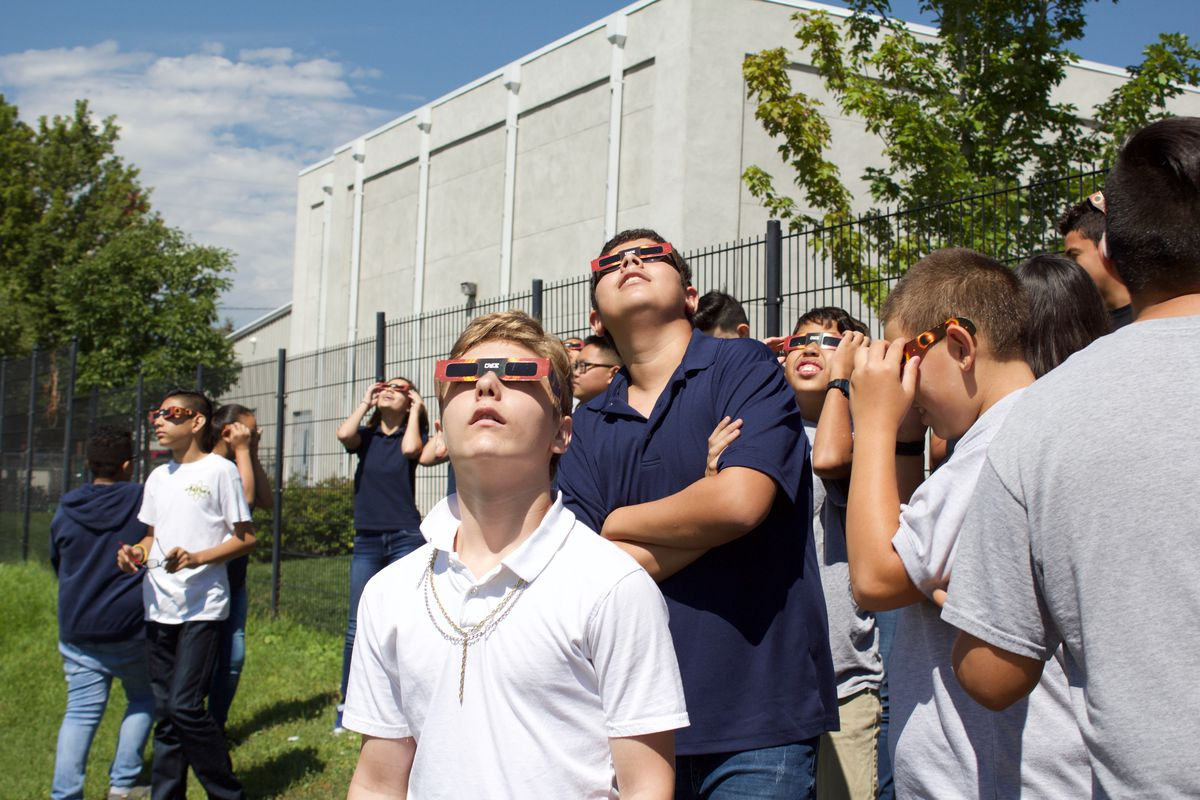 Students at Scott Carpenter Middle School take in the total solar eclipse. (Photo by Marissa Page/Chalkbeat)